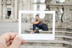 Man resting in front of the Porto Cathedral Stock Images