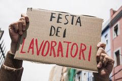 Text may day in italian in a brown signboard royalty free stock photography