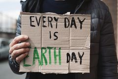 Text every day is Earth day in a brown signboard stock photo