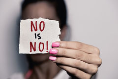 Woman showing a note with the text no is no Royalty Free Stock Photo