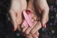 Woman with a pink ribbon for the breast cancer awareness royalty free stock images