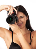 Closeup of young cheerful woman with camera Royalty Free Stock Photo