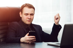 Closeup young concentrated business man writing the message Stock Image
