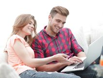 Closeup of young couple with laptop. On a light background Stock Images