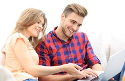 Closeup of young couple with laptop. On a light background Stock Photography