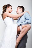 Closeup of a young couple in love, man stands with his back to the camera, she bites his ear. Playful couple. her legs Royalty Free Stock Image