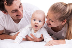 Closeup of young family with baby boy over white Royalty Free Stock Photos