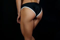 Closeup young female athlete back, trained buttocks, fit shape Royalty Free Stock Photography
