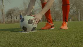 Soccer player placing the ball on penalty spot stock video