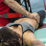 Closeup of Young Girl doing Fitness Traction Therapy on Bed Stock Photography