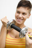Closeup of young girl holding weight stock photography