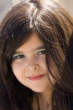 Closeup of young girl with long brown hair. A closeup of a young hispanic girl with long brown hair Stock Photography