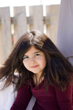 Closeup of young girl with long brown hair Royalty Free Stock Photography