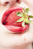 Strawberry in the mouth Royalty Free Stock Images