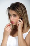 Closeup of a young girl on the phone Royalty Free Stock Photography