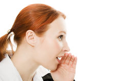 A closeup of a young girl whispering Stock Photography