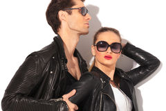 Closeup of a young hot couple in leather jackets Royalty Free Stock Images