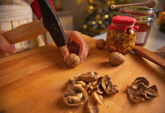 Closeup on young housewife chopping walnuts Stock Images