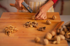 Closeup on young housewife chopping walnuts Royalty Free Stock Image