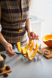 Closeup on young housewife cooking pumpkin Royalty Free Stock Photos
