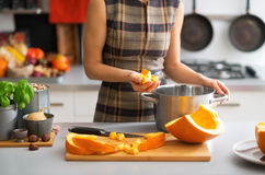 Closeup on young housewife cooking pumpkin Stock Photo