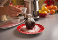 Closeup on young housewife decorating apple in chocolate glaze Royalty Free Stock Image