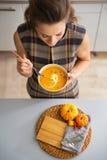 Closeup on young housewife eating pumpkin soup Stock Image