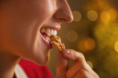 Closeup on young housewife eating walnuts Royalty Free Stock Photo