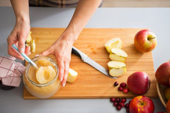 Closeup on young housewife making apple jam Stock Photo