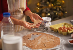 Closeup on young housewife making christmas cookies Royalty Free Stock Images