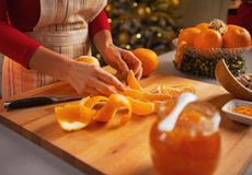 Closeup on young housewife making orange jam Stock Photo