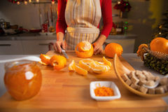 Closeup on young housewife making orange jam. In kitchen Royalty Free Stock Photography