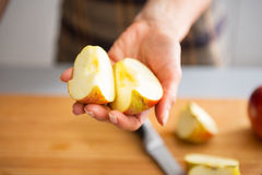 Closeup on young housewife showing apple slices Stock Photo