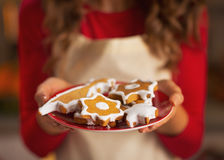 Closeup on young housewife showing christmas cookies Royalty Free Stock Images
