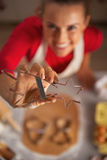Closeup on young housewife showing dough cutter Royalty Free Stock Images