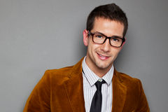 Closeup of young interesting businessman with rimmed glasses Stock Photos