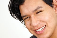 Closeup of young latino man smiling. Portrait of cute young latino man smiling and looking Stock Images