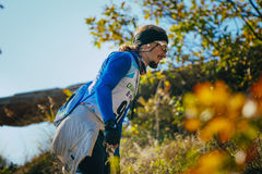 Closeup of young male athlete in headband and glasses. autumn landscape Royalty Free Stock Images