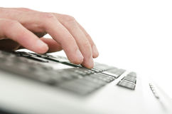 Young man typing on computer Stock Photo