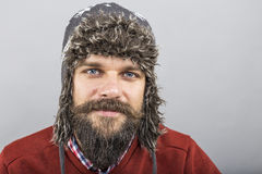 Closeup of young man with beard wearing a winter hat Stock Image
