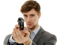 Closeup of a young man with a gun Royalty Free Stock Images