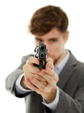 Closeup of a young man with a gun Royalty Free Stock Image