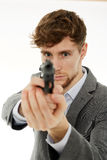 Closeup of a young man with a gun Royalty Free Stock Photos