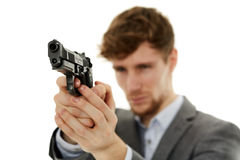 Closeup of a young man with a gun Royalty Free Stock Photography