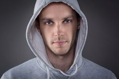 Closeup of young man with hand on head Royalty Free Stock Photos