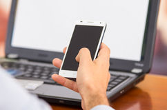 Closeup of young man hands holding smartphone with Royalty Free Stock Photography