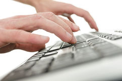 Closeup of  young man hands typing on computer keyboard Stock Images