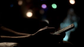 Closeup of young man hands typing sms scrolling pictures phone tilt down. Closeup of young man hands typing sms scrolling pictures phone night lights tilt down stock footage