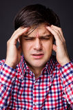 Closeup of a young  man with headache Stock Photography