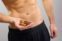 Closeup of young man holding organic nuts Stock Images